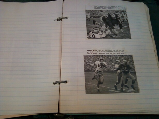 Image description: 2 newspaper clippings containing black and white photos from reports on old college American football games are glued onto a ruled page of binder paper in a scrapbook. In the pictures from the clippings, white men play American football. In the top clipping, a scrum of football players appears. In the bottom clipping, a white man wearing a number 16 jersey runs with a fooball while two other white men stand nearby, one wearing a dark jersey, possibly with a number 38 on it. There is text above the photos in the clippings, but it is not entirely legible in the picture.