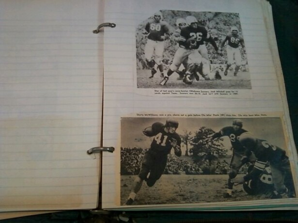 Image description: 2 newspaper clippings containing black and white photos from reports on old college American football games are glued onto a ruled page of binder paper in a scrapbook. In the pictures from the clippings, white men play American football. In the top clipping, 4 football players are visible, and at the center, one of them is grabbing number 26 from behind as numbers 60, left, and 86, right, look on. In the bottom clipping, a white man wearing a number 41 jersey runs with a fooball, left, while a scrum of 3 other men struggle with each other to the right of the phot. There is text above the photos in the clippings, but it is not entirely legible in the picture.