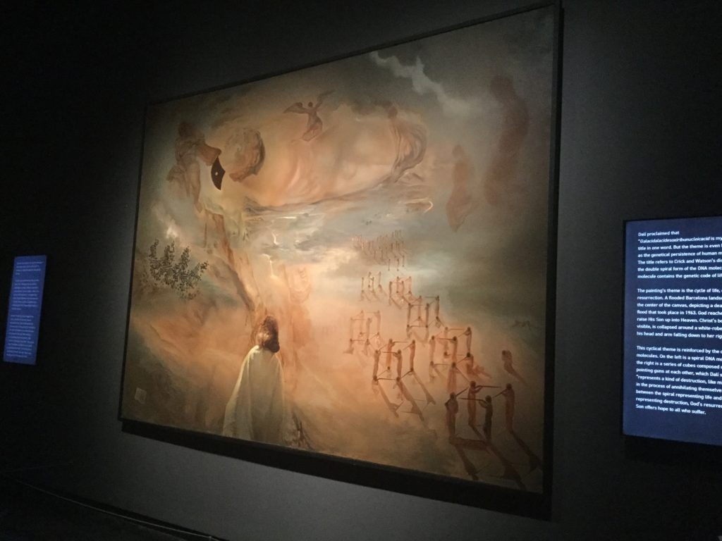 "Salvador Dali's ""Galacidalacidesoxiribunucleicacid (Homage to Crick and Watson)"" painting. The link directly below this image and its caption goes to the Dali Museum's page on the painting, and gives a detailed description of the painting and its history."