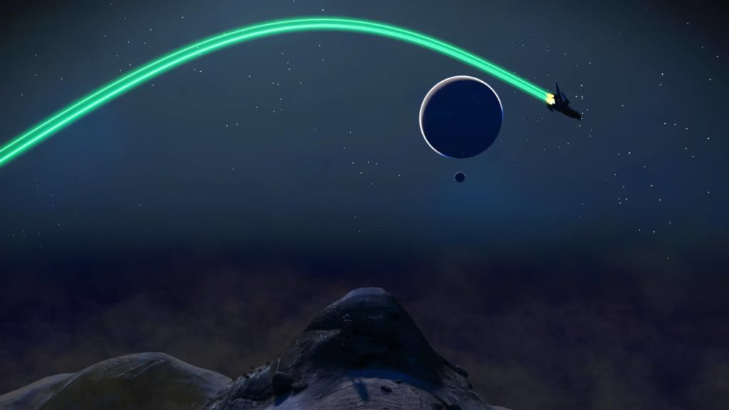 Screenshot from the video game No Man's Sky. A space ship flies through a star-lit stretch of outer space, past the silhouette of a planet, and over grey hills on the horizon, leaving a green vapor trail behind it.